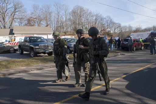 NEWTOWN, CT - DECEMBER 14: Connecticut State Police walk near the scene of an elementary school shooting on December 14, 2012 in Newtown, Connecticut. According to reports, there are more than 20 dead, most children, after a gunman opened fire in at the Sandy Hook Elementary School. The shooter was also killed. (Photo by Douglas Healey/Getty Images)