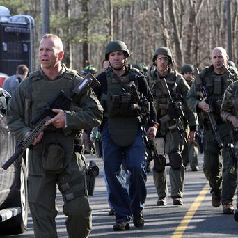 Heavily armed Connecticut state troopers on the scene at Sandy Hook School following the shooting (AP/The Journal News, Frank Becerra Jr)