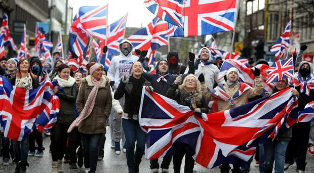 Anger: scenes such as the City Hall flag protests and riot police back on the streets have damaged Northern Ireland's image