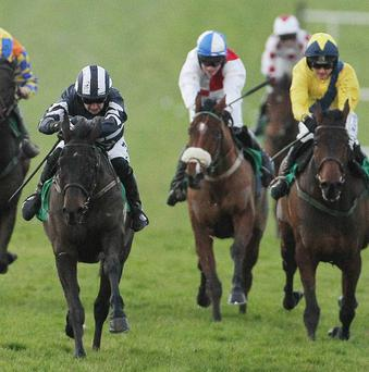 Patrick Mullins surges to the front on Union Dues (left)
