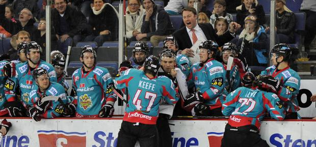 Doug Christiansen screams from behind the bench as Adam Keefe clashes with Cardiff's Paul Bissonnette
