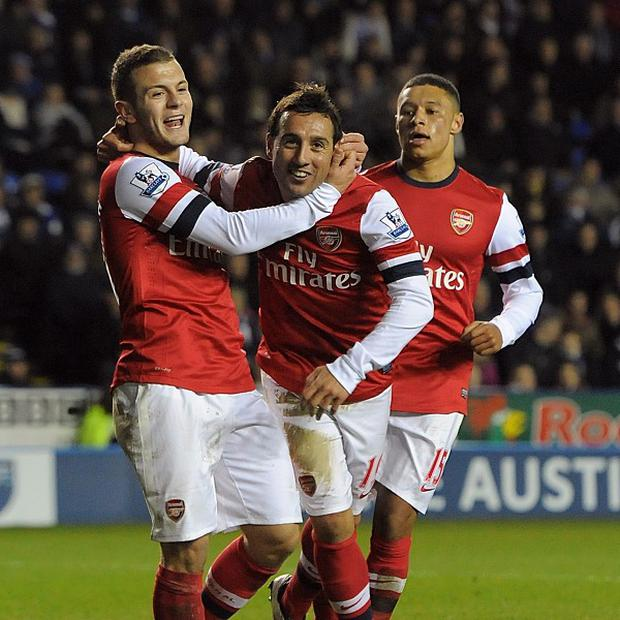 Santi Cazorla, centre, celebrates scoring Arsenal's fourth goal to complete his hat-trick against Reading