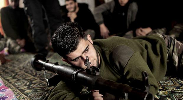 Syrian rebels are reportedly fighting in a Damascus refugee camp against armed Palestinians loyal to President Bashar Assad (AP)