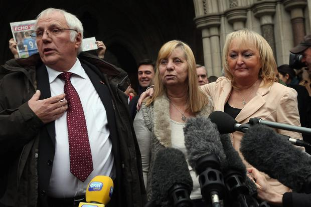 LONDON, UNITED KINGDOM - DECEMBER 19: Trevor Hicks of the Hillsborough Family Support Group and his former wife Jenni Hicks (R), who lost their two teenage daughters Sarah and Victoria in the Hillsbrough disaster, join Margaret Aspinall, who lost her son James, outside the High Court on December 19, 2012 in London, England. An application presented by the Attorney General, Dominic Grieve to Lord Chief Justice, Lord Judge has resulted in the quashing of the original accidental death verdict and an order for fresh inquests. The Hillsborough disaster occurred during the FA Cup semi-final tie between Liverpool and Nottingham Forest football clubs in April 1989 at the Hillsborough Stadium in Sheffield, which resulted in the deaths of 96 football fans. (Photo by Dan Kitwood/Getty Images)