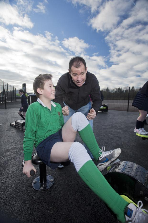 Ex Ireland and Ulster rugby player Andy Ward puts Thomas Gilpin from Ballynahinch High School through his paces at the new outdoor gym. Brian Morrison