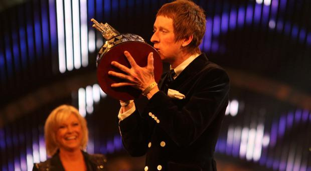Winner of Sports Personality of the Year 2012, Bradley Wiggins kisses the trophy during the BBC Sports Personality of the Year Awards 2012 at ExCeL Arena, London