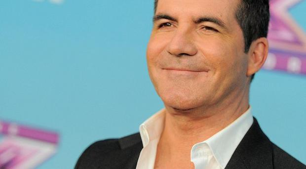 Simon Cowell admitted he's been on dates with the 'adorable' Carmen Electra