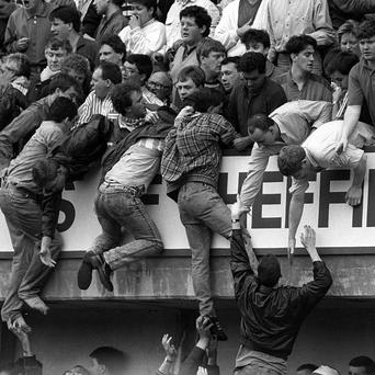 Liverpool fans try to escape severe overcrowding at Hillsborough in April 1989
