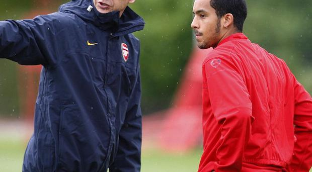 Arsene Wenger, left, believes Theo Walcott, right, will stay at Arsenal