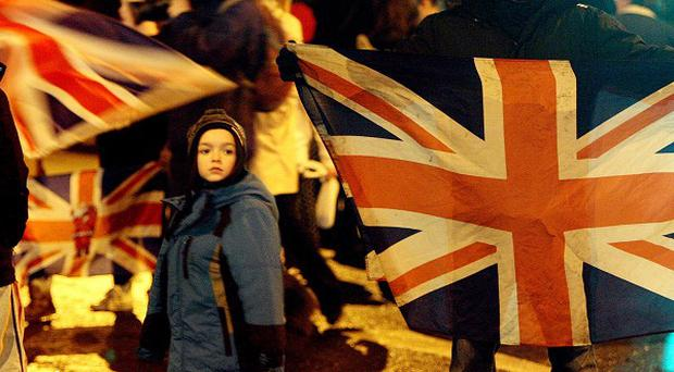 Loyalists block the Sandy Row area of Belfast as part of a mass protest over flags