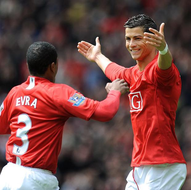 Patrice Evra, left, wants Cristiano Ronaldo, right, to return to Manchester United