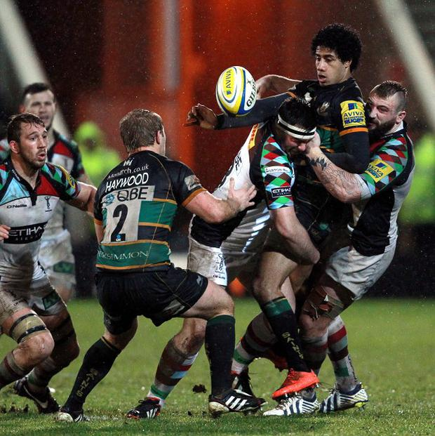 Leaders Harlequins overcame Northampton in wet conditions