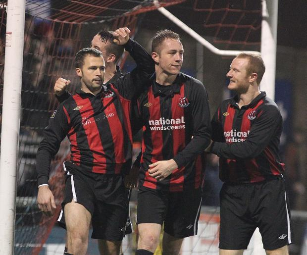 David Rainey is congratulated by team-mates after Crusaders' last-gasp equaliser against Linfield