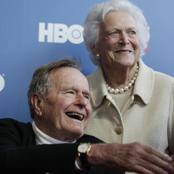 Former President George HW Bush is in hospital with a fever (AP)