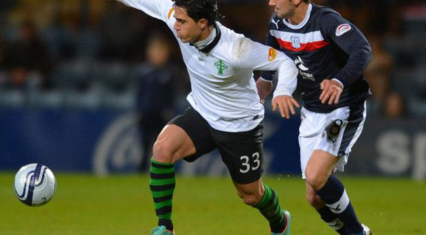 Dundee's Gary Irvine and Celtic's Beram Kayal (left) battle for the ball during the Clydesdale Bank Scottish Premier League match at Dens Park, Dundee