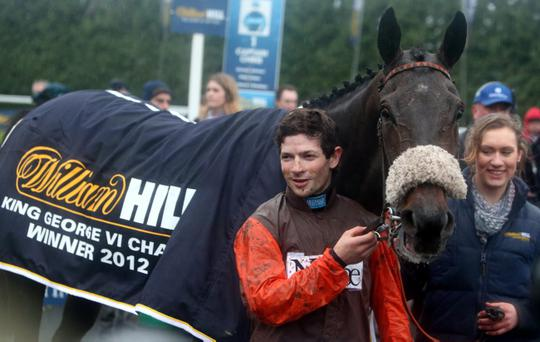 Long Run and jockey Sam Waley-Cohen celebrate winning the King George VI Chase during the William Hill Winter Festival at Kempton Park Racecourse, Middlesex