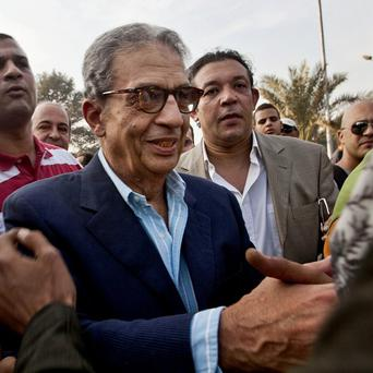 Egypt's Ex- foreign minister and presidential candidate Amr Moussa is being investigated over accusations he and other opposition leaders incited the overthrow of the regime (AP)