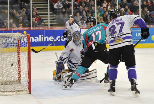 Greg Stewart scores in over-time to win the game for the Belfast Giants in Thursday night's memorable 4-3 victory over Braehead Clan at the Odyssey Arena