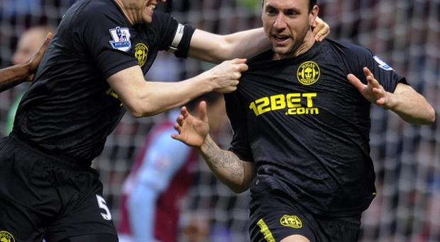 Ivan Ramis, right, celebrates scoring Wigan's first goal