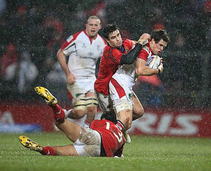 Ulster's Adam D'Arcy is tackled by Munster's Casey Laulala and Conor Murray