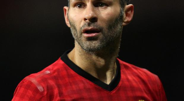 Ryan Giggs insists Manchester United can not ease off in pursuit of the title