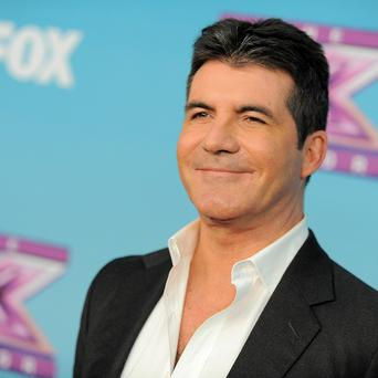 Simon Cowell has been hanging out with his exes Sinitta and Mezhgan