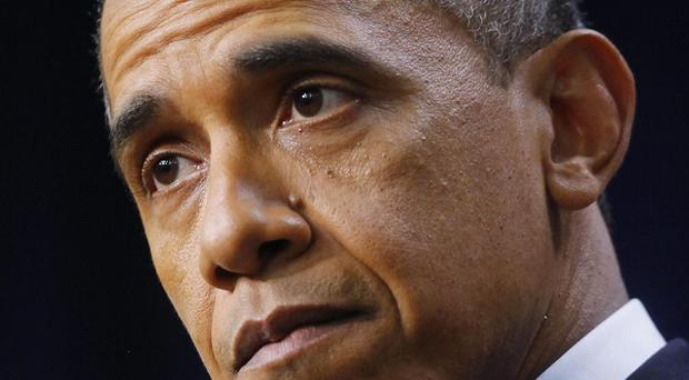 Barack Obama pauses as he speaks about the fiscal cliff (AP)