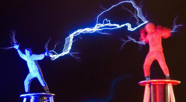 The Lords of Lightning throw thousands of volts of electricity at each other as Derry~Londonderry's year as the 2013 UK City of Culture started with a spectacular display of street entertainment, music and fireworks.