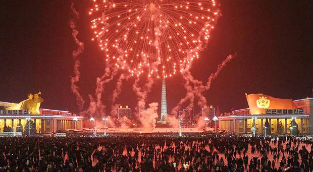Fireworks explode over Kim Il Sung Square in celebration of the new year in Pyongyang, North Korea (AP/Kyodo News)