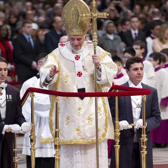 Pope Benedict XVI blesses the faithful as he leaves after celebrating a mass in St Peter's Basilica at the Vatican (AP)