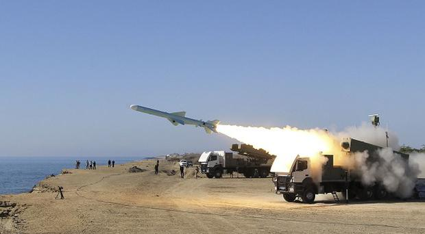 A Ghader missile is launched from the area near the Iranian port of Jask port on the shore of the Oman Sea during an Iranian navy drill (AP)