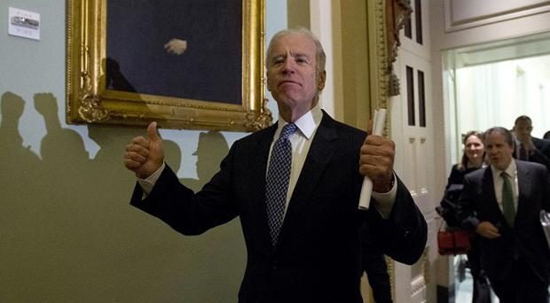 Vice president Joe Biden gives two thumbs up following a Senate Democratic caucus meeting about the fiscal cliff on Capitol Hill (AP)