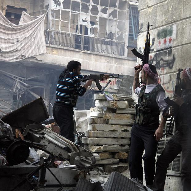 Free Syrian Army fighters fire at enemy positions during heavy clashes with government forces in Aleppo, Syria (AP)