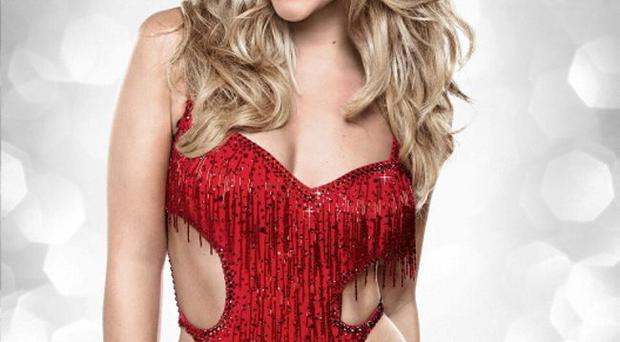 Kimberley Walsh proves that a red dress can make an amazing impact