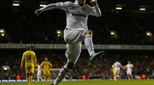 LONDON, ENGLAND - JANUARY 01: Clint Dempsey of Tottenham Hotspur celebrates scoring their third goal during the Barclays Premier League match between Tottenham Hotspur and Reading at White Hart Lane on January 1, 2013 in London, England. (Photo by Clive Rose/Getty Images)