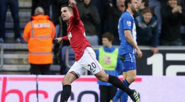 WIGAN, ENGLAND - JANUARY 01: Robin van Persie of Manchester United celebrates after scoring the second goal during the Barclays Premier League match between Wigan Athletic and Manchester United at the DW Stadium on January 1, 2013 in Wigan, England. (Photo by David Rogers/Getty Images)