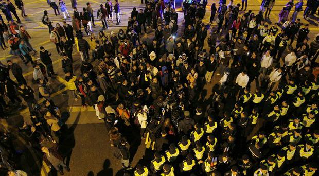 Anti-government protesters block the main road on New Year's Day in Hong Kong (AP)