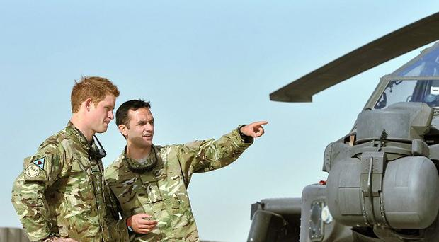 Helicopter co-pilot Prince Harry, left, is currently stationed at Camp Bastion in Afghanistan