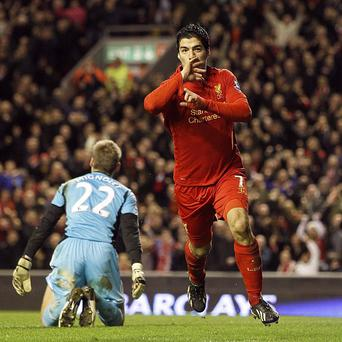 Luis Suarez celebrates scoring his second and Liverpool's third goal of the game against Sunderland