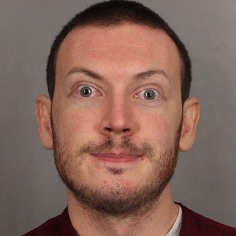 James Holmes is currently awaiting trial for the murder of 12 people during a midnight screening of The Dark Knight Rises (AP)