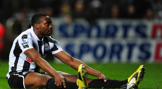 NEWCASTLE UPON TYNE, ENGLAND - JANUARY 02: Dejected Newcastle striker Shola Ameobi looks on during the Barclays Premier League match between Newcastle United and Everton at St James' Park on January 2, 2013 in Newcastle upon Tyne, England. (Photo by Stu Forster/Getty Images)