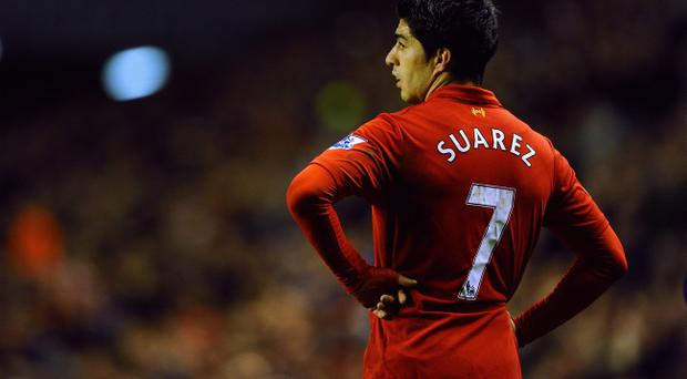LIVERPOOL, ENGLAND - JANUARY 02: Luis Suarez of Liverpool looks on during the Barclays Premier League match between Liverpool and Sunderland at Anfield on January 2, 2013 in Liverpool, England. (Photo by Laurence Griffiths/Getty Images)