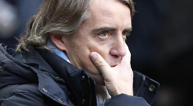 Roberto Mancini, pictured, is due to explain his comments about referee Kevin Friend