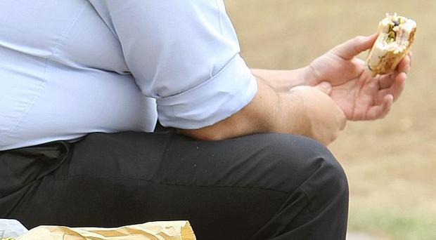 People who are overweight and claiming benefits could be given smart cards to monitor the exercise they do, a report says