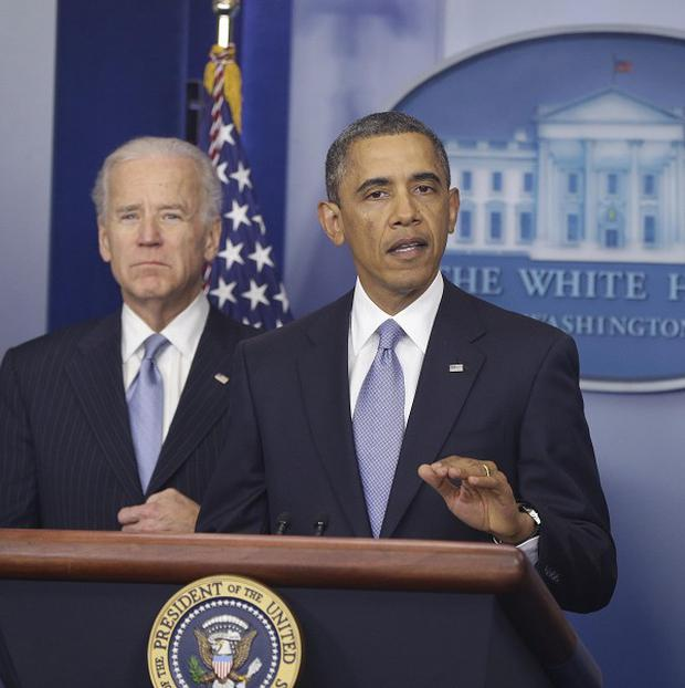 President Barack Obama and Vice President Joe Biden make a statement regarding the passage of the fiscal cliff bill (AP/Charles Dharapak)