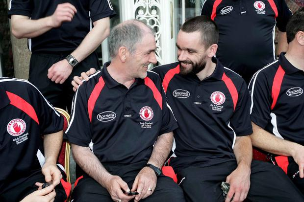 Success is now following Ryan McMenamin, pictured with Tyrone boss Mickey Harte, into the managerial field