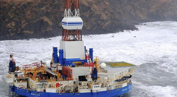 Drilling rig Kulluk aground off a small island near Kodiak Island (AP/US Coast Guard)