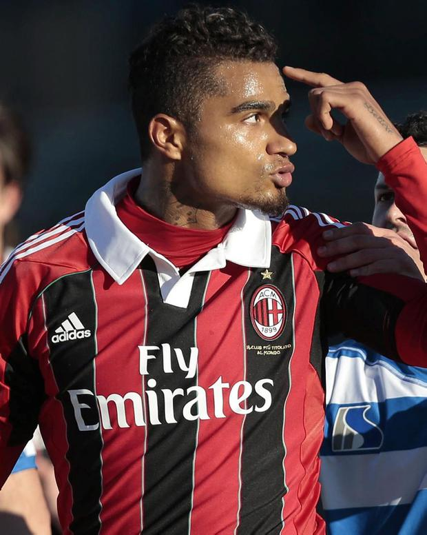 AC Milan and Ghana midfielder Kevin-Prince Boateng gestures towards the crowd in Busto Arsizio, near Milan, Italy, Thursday, Jan. 3, 2012. A friendly match between AC Milan and lower division club Pro Patria was abandoned Thursday after racist chants directed at Milan's black players, the latest incident of racial abuse that continues to blight the sport. After repeated chants directed his way, Ghana midfielder Kevin-Prince Boateng picked up the ball and kicked it at a section of the crowd in the 26th minute of the first half. Boateng then took off his shirt and walked off the pitch with his Milan teammates. Urby Emanuelson, Sulley Muntari and M'Baye Niang were also targeted by the chants. (AP Photo/Emilio Andreoli)