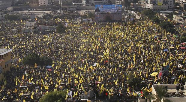 Tens of thousands of Palestinian supporters of the Fatah party staging a mass rally in Gaza (AP)