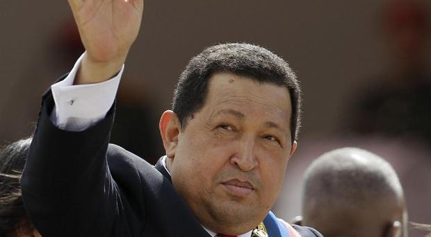 Venezuela's President Hugo Chavez is recovering from cancer surgery in Cuba (AP/Ariana Cubillos)